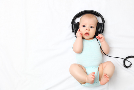 funny baby little boy in headphones Stock Photo - 55136892