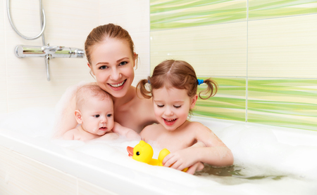 bath: bathing in a bath with foam mother together children baby
