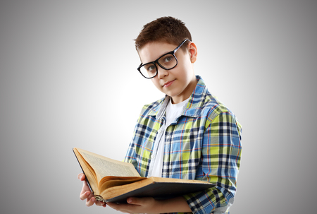 funny glasses: funny child boy teenager with glasses and book