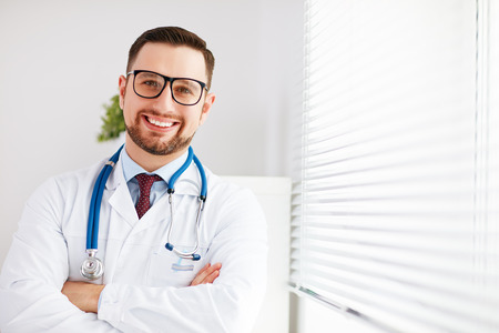 friendly male doctor in his office at the clinic 版權商用圖片