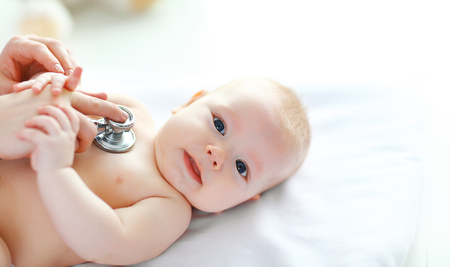 the Doctor pediatrician stethoscope listening to baby