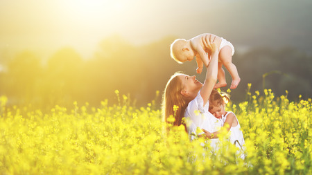happy family, mother and children daughter and baby son on meadow with yellow flowers Stok Fotoğraf - 59132583