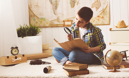 child boy teenager studying a map of the world, globe, geography, dreams of travel Stok Fotoğraf - 63077527