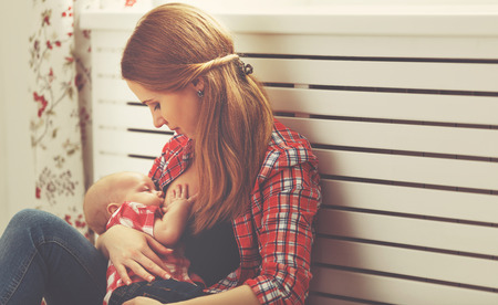 mother breast feeding her baby toddler