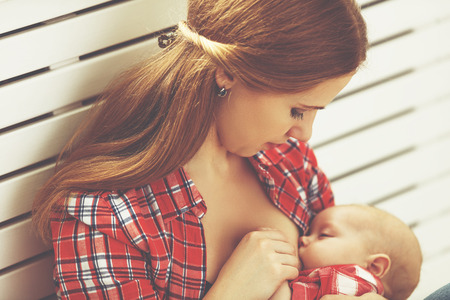 mother breast: mother breast feeding her baby toddler