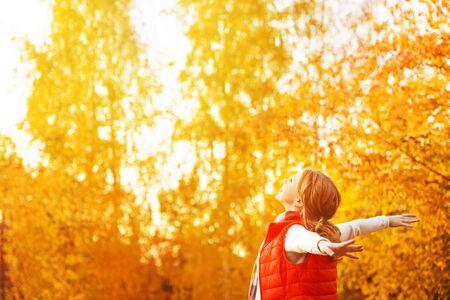 enjoying life: happy girl enjoying life and freedom in the autumn on the nature
