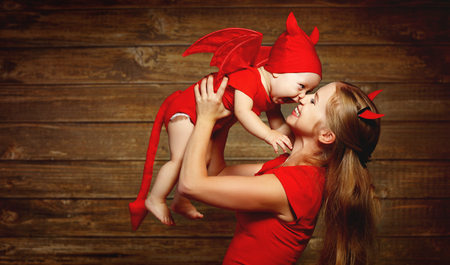 mother and baby son having fun and celebrate Halloween in devil costume