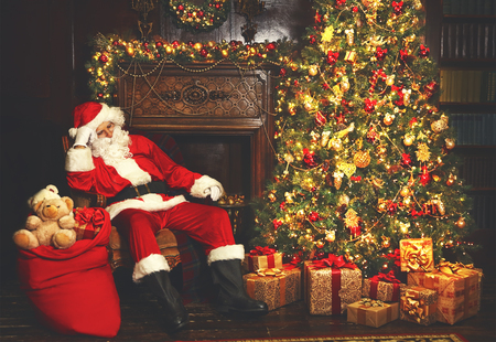 asleep chair: Christmas. Santa tired asleep in chair near Christmas tree and bag with gifts