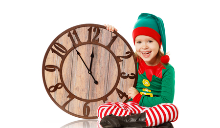 Christmas concept. Little Elf child with clock isolated on white Stock Photo