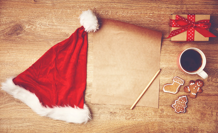 wish list for Christmas gifts and the presents on a wooden table Stock Photo