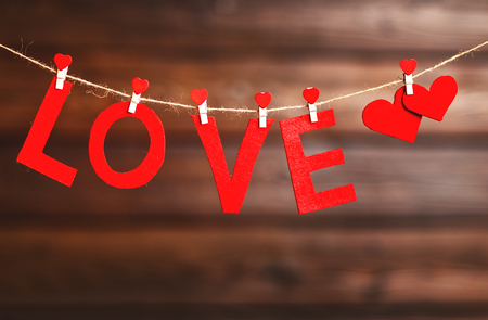 wood texture: background Valentines day. two red hearts and the word Love on the wooden background