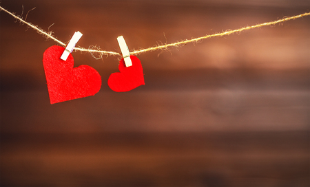 background Valentines day. two red hearts on a wooden background Stock Photo