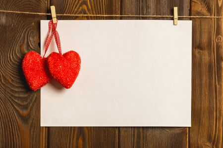 letter: Card to day of St. Valentine. blank empty paper sheet and a red heart on a wooden background Stock Photo