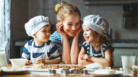 happy family in the kitchen. mother and  children preparing the dough, bake cookies Stok Fotoğraf - 70776739