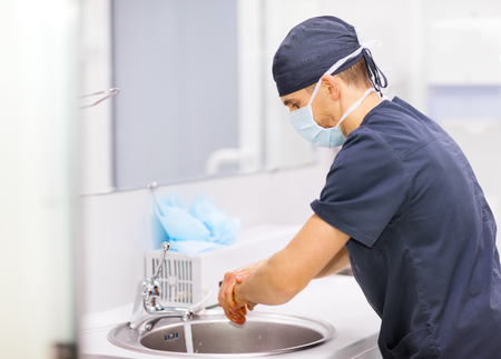 Antibacterial: Doctor Surgeon washing hands before operation