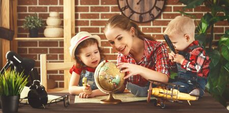Happy family of mother and children prepareto  travel trip, learn for route map  Stock Photo