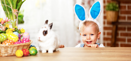 happy easter! happy funny baby boy playing with Easter bunny Stock Photo - 72814166