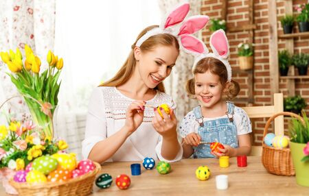pascuas navideÑas: Happy easter! family mother and child daughter paint eggs for holiday Easter at home