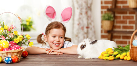 happy smiling: happy easter! happy funny child girl playing with Easter bunny