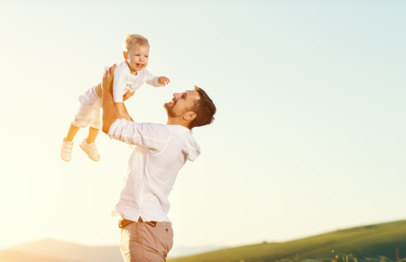 Fathers day. Happy family father and toddler son playing and laughing on nature at sunset