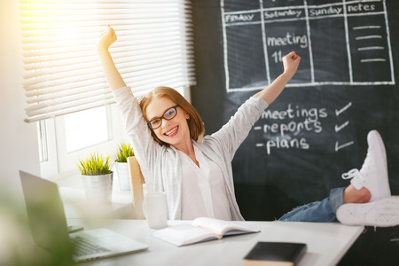 web: Happy businesswoman woman with computer and mobile phone Stock Photo