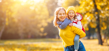 happy family mother and child daughter playing and laughing on   autumn walk Фото со стока - 86199800