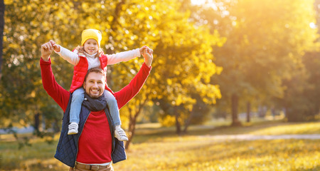 happy family father and child girl daughter playing and laughing in autumn park Stock Photo