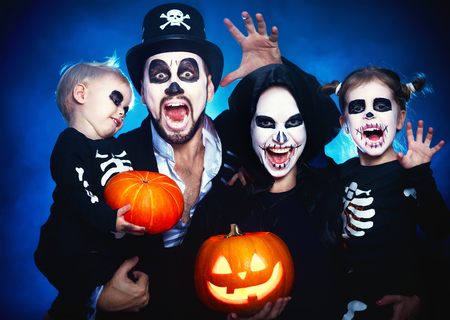 happy family mother father and children in costumes and makeup on a celebration of Halloween Stock Photo