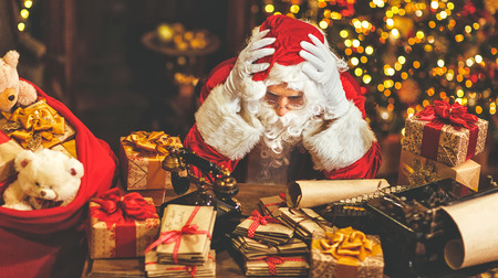 Santa Claus was tired under stress with a headache Imagens