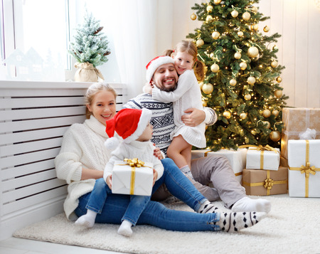 happy family mother father and children at home on Christmas morning  Stock Photo