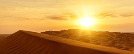 a sandy desert barkhans at sunset  Stock Photo