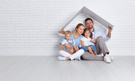 concept housing a young family. mother father and children in a new home  Stock Photo