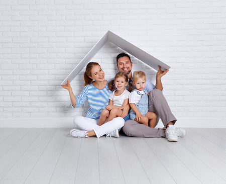 concept housing a young family. mother father and children in a new home  Stock fotó