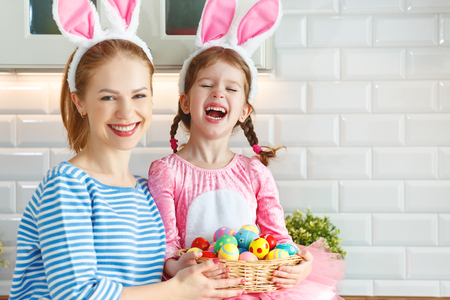 Happy easter! family mother and child daughter with ears hare getting ready for holiday  Stock Photo