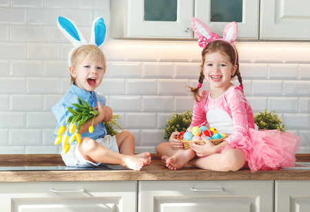 Happy easter! funny funny children boy and girl with ears hare getting ready for holiday Stock Photo - 97757787