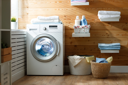 Interior of a real laundry room with a washing machine at the window at home Archivio Fotografico
