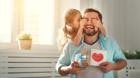 Fathers day. Happy family daughter hugging dad and laughs on holiday  Stock Photo