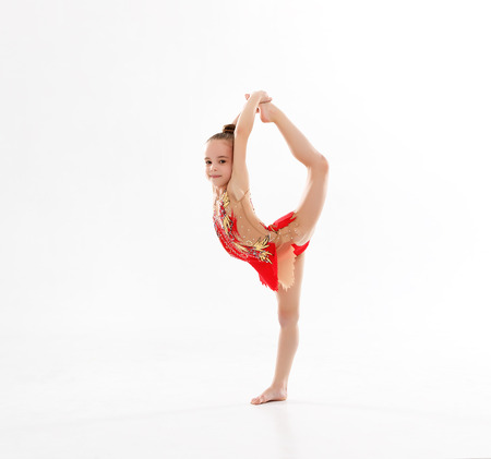 child girl gymnast doing sports in rhythmic gymnastics on white background
