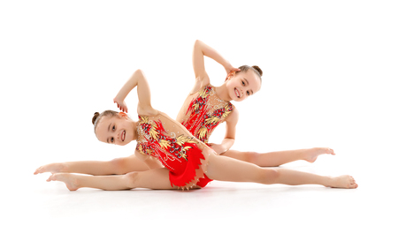 children girls gymnast doing sports in rhythmic gymnastics on white background