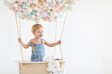 cute happy baby boy in a fairy magic hot air balloon