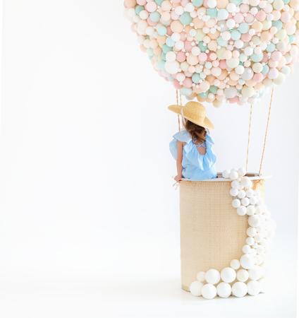 cute charming child girl in a fairy magic hot air balloon Stock fotó - 100277475