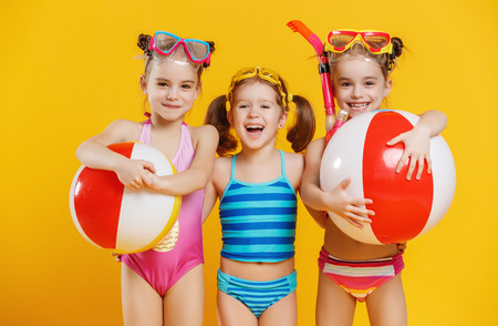 funny funny happy children  jumping in swimsuit and swimming glasses jumping on colored background Banque d'images - 101297320