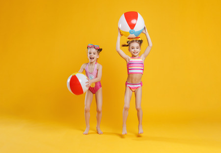 funny funny happy children in bathing suits and swimming glasses jumping on colored background 免版税图像 - 101297432