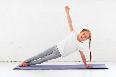 child girl doing yoga and gymnastics in the gym Banco de Imagens - 102008153