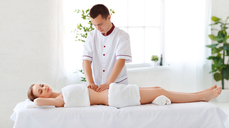 A beautiful girl enjoys massage and spa treatments