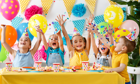 Childrens birthday. happy kids with cake and balloons