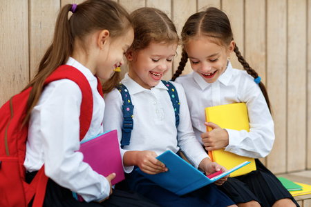 Happy children girls girlfriend schoolgirl student elementary school Zdjęcie Seryjne