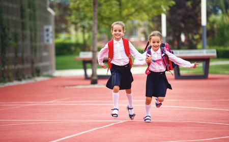 Happy children girls girlfriend schoolgirl student elementary school 写真素材