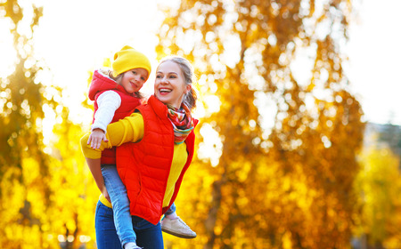 happy family mother and child daughter playing and laughing on   autumn walk Zdjęcie Seryjne