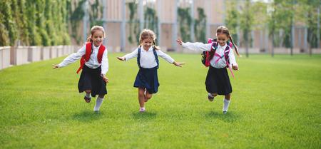 Happy children girls girlfriend schoolgirl student elementary school Banco de Imagens